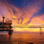 silhouette of an oil and gas offshore platform during sunset time