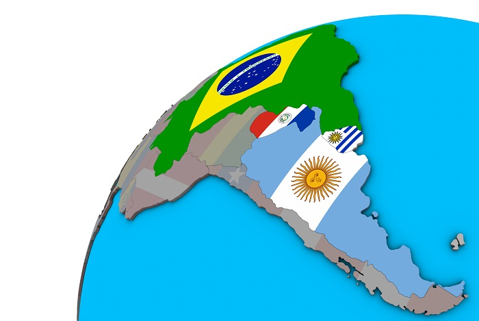 Mercosur memebers with national flags on 3D globe.
