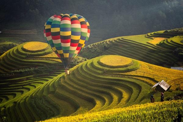 Hot air balloon over rice field in Mu cang chai, Vietnam