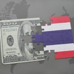 puzzle with the national flag of thailand and dollar banknote on a world map background.