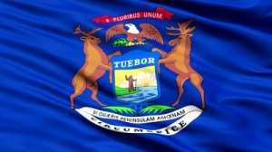 stock-footage-waving-flag-of-the-us-state-of-michigan-with-the-coat-of-arms-supported-by-an-elk-and-moose