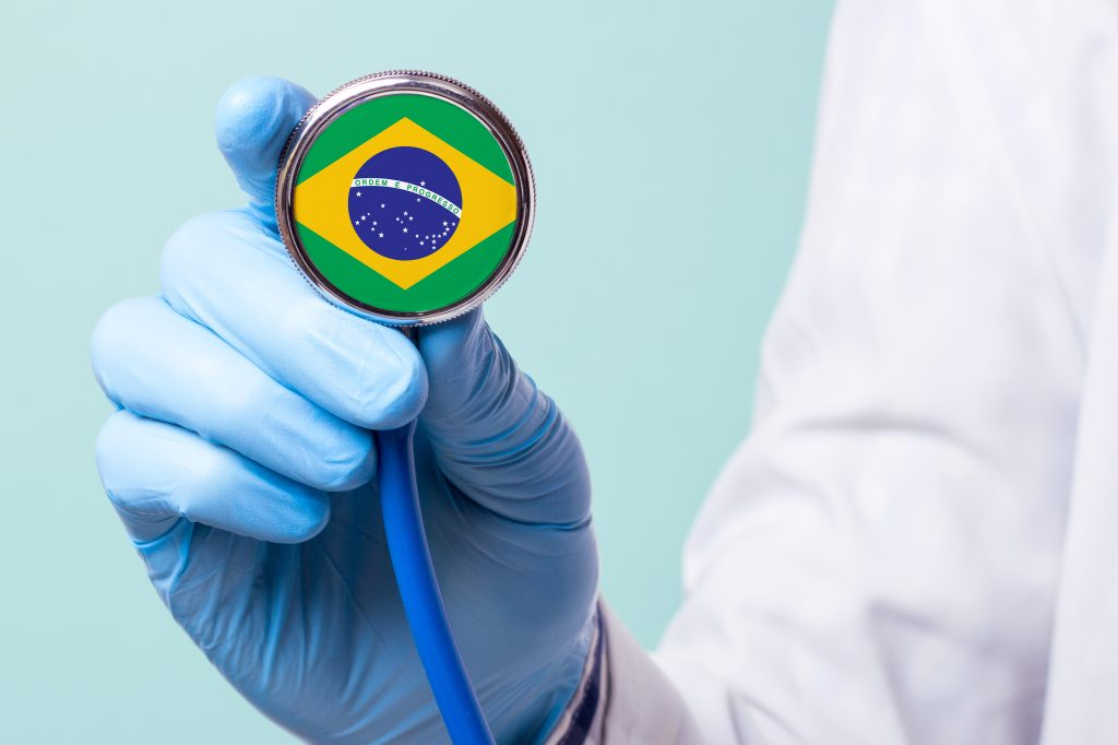 Medicine in brazil is free and paid. Expensive medical insurance. Treatment of disease at the highest level Doctor holding a stethoscope in his hand