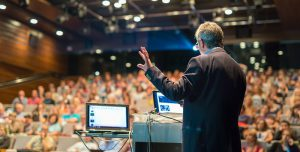 Speaker,Giving,A,Talk,On,Corporate,Business,Conference.,Audience,At