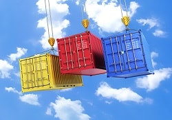 Four shipping containers during transport on a sky background