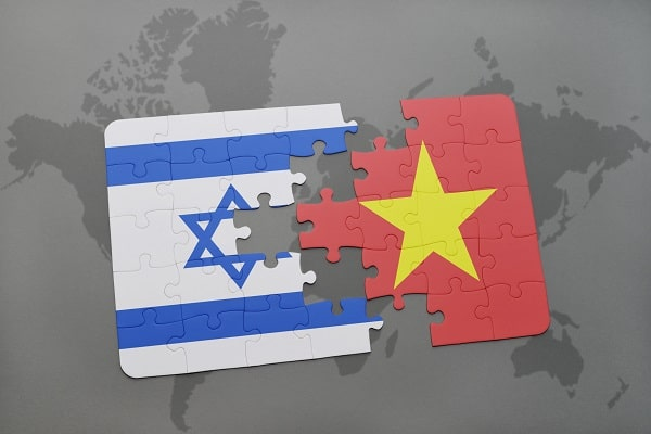 puzzle with the national flag of israel and vietnam on a world map background. 3D illustration