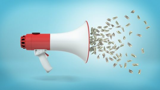 3d rendering of a large red and white megaphone in a side view with many dollar bills flying out of it on a blue background.