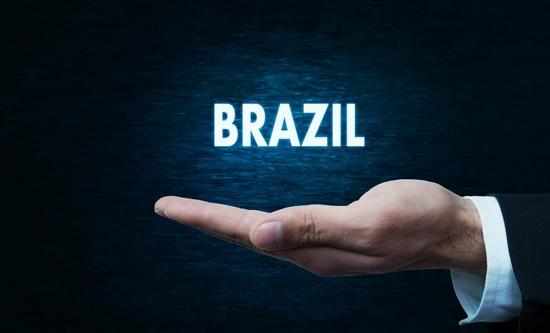 Hand holding Brazil word