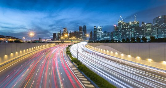 Movement of car light with Singapore cityscape skyline during twilight